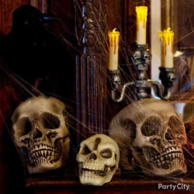 Rest In Peace Skulls & Candelabra Mantel Idea