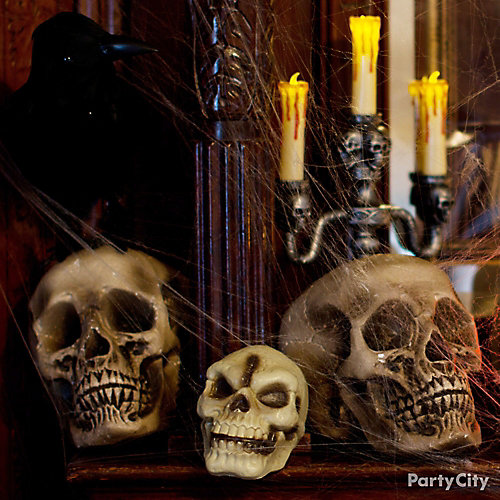 Rest In Peace Skulls and Candelabra Mantel Idea